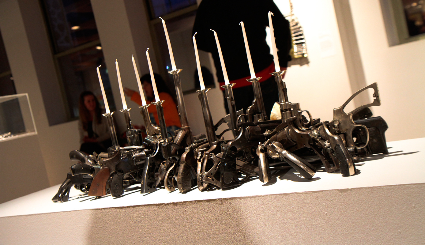 "Carnegie Mellon alumnus Boris Bally's ""Loaded Menorah"" is among the pieces that depict the violent world in which we live. (credit: Jonathan Carreon/Contributing Editor)"
