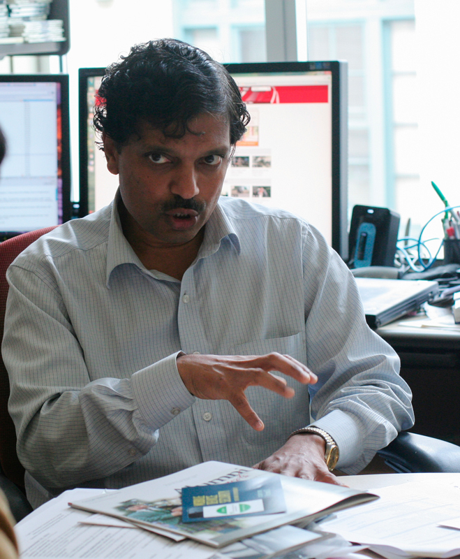 Ragunathan Rajkumar, the director of Carnegie Mellon's Technologies for Safe and Efficient Transportation, discusses his work on vehicle sensors that can detect other cars, pedestrians, and even red lights. (credit: Michelle Wan/Junior Photographer)