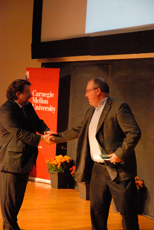 University provost Mark Kamlet (left) congratulates Mark Burd (right), a member of the TSB Marketing and Communications Team, which won the Andy Award for Outstanding Innovation.  (credit: Kate Groschner/Photo Editor)