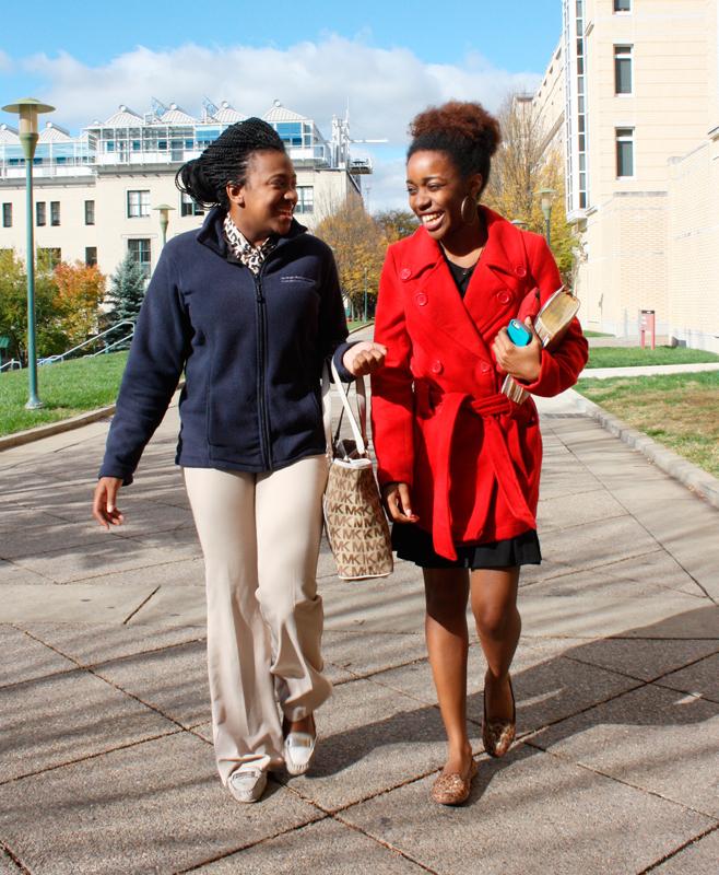 Senior statistics major Demaris Bells (left) and senior finance and Hispanic studies double major Alexis Jenkins sport a fleece zip-up and a trench-style pea coat. (credit: Sara Remi Fields/)