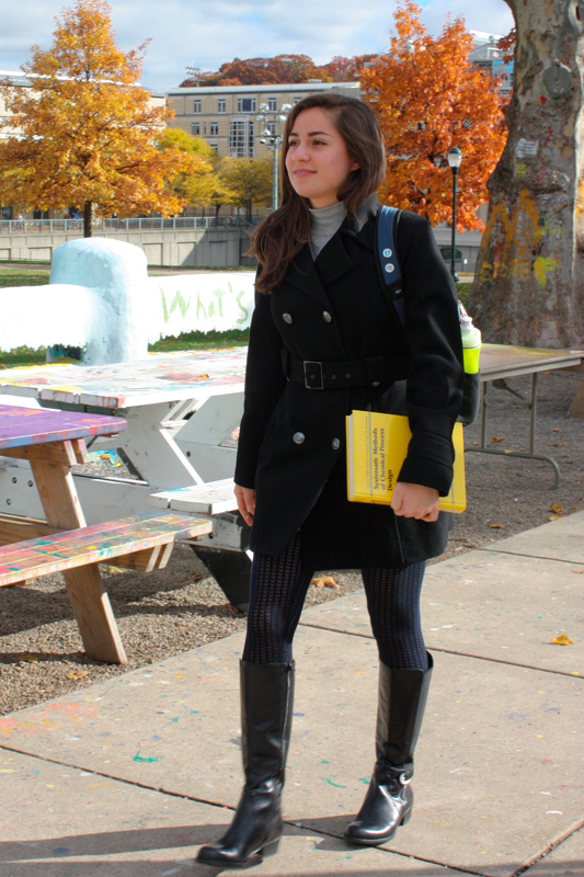 Senior chemical engineering major Michelle Ruiz pairs tights with boots under a pea coat. (credit: Sara Remi Fields/)