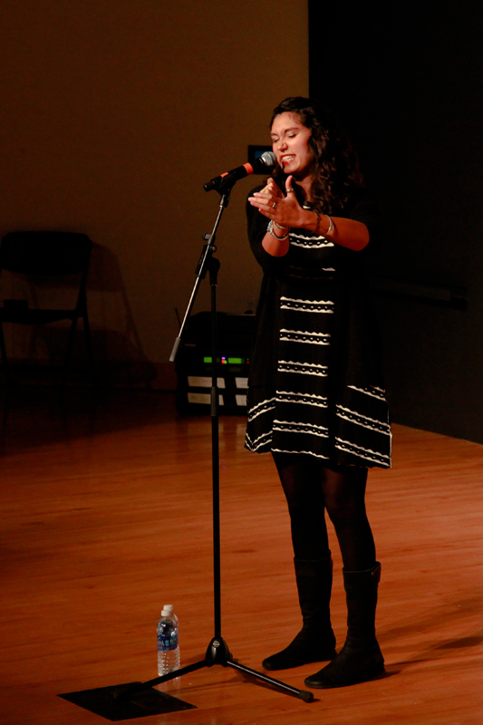 Spoken word poet and Project V.O.I.C.E founder Sarah Kay performed for a large crowd in McConomy Auditorium. (credit: Michelle Wan/Junior Photographer)