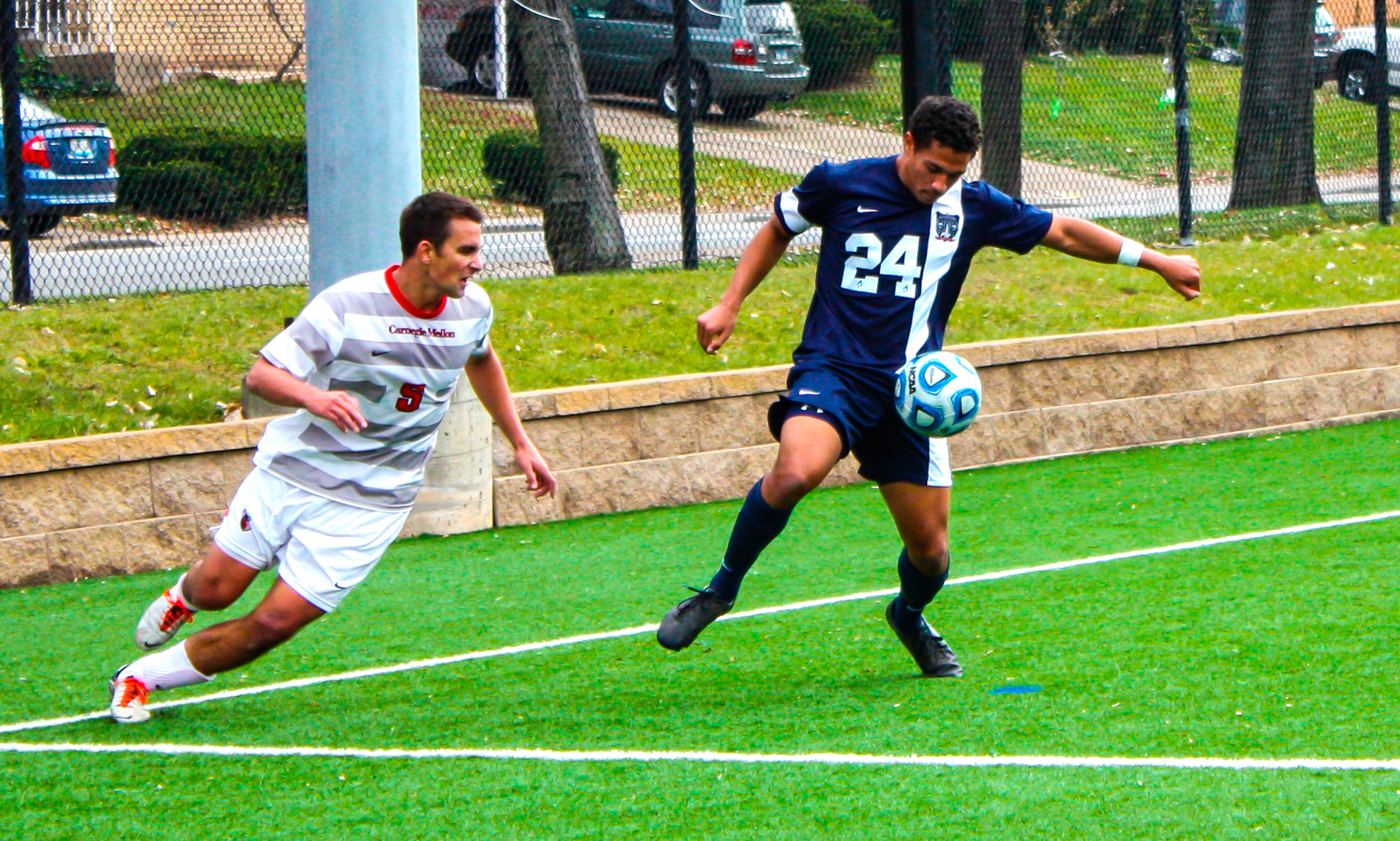 Senior midfielder Matt Sarett challenges a Virginia Wesleyan player. Sarett missed Sunday's game due to an injury. (credit: Staff Photographer)