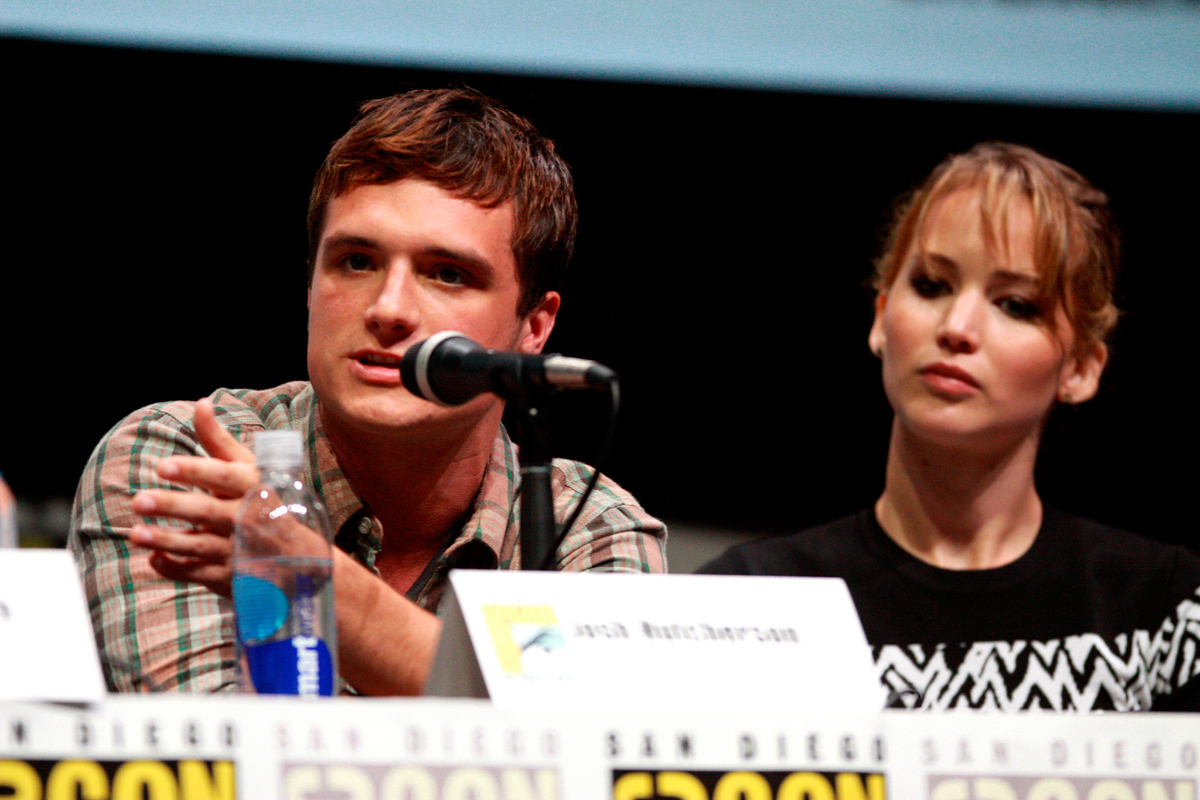 Josh Hutcherson (left) and Jennifer Lawrence promote one of the most highly anticipated film releases this season, _The Hunger Games: Catching Fire_. (credit: Courtesy of Gage  Skidmore via Flickr)