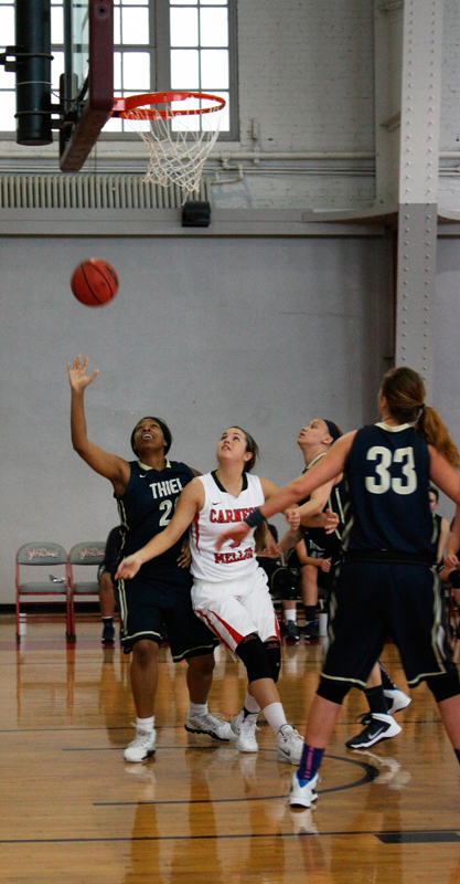 Sophomore Amanda McHenry battles for an offensive rebound. (credit: Staff Photographer)