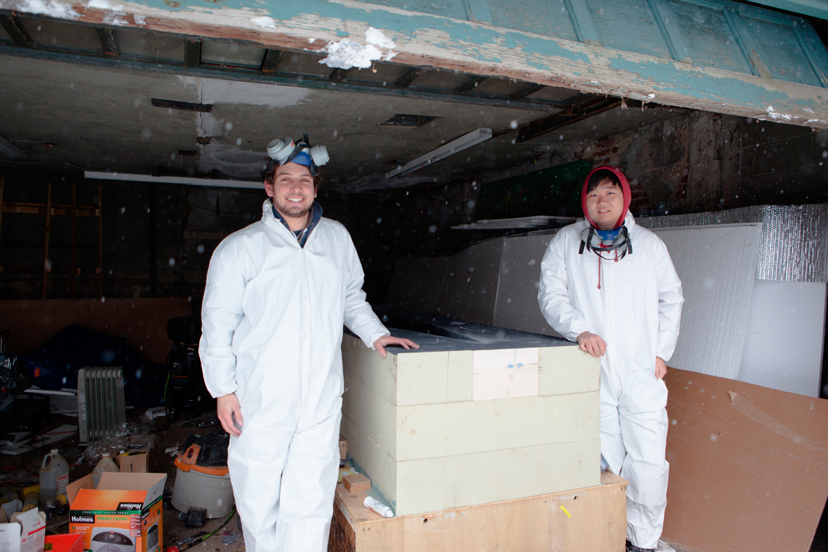 Nathaniel Krasnoff and KJ Lee pose at Bramer House, one of the team's two building sites. The teammates are sporting new hazmat suits and other Breaking Bad-inspired gear.  (credit: Jonathan Leung/Photo Editor)