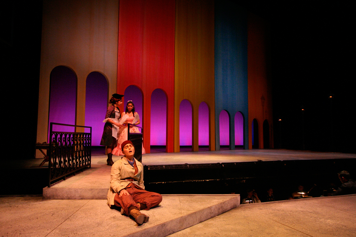 Lazuki (music master's student Courtney Elviram sitting) is a poor peddler who falls in love with the beautiful princess Laoula (junior vocal performance major Stephanie Ramos, standing) in _L'etoile_. (credit: Courtesy of Christine Lee and Shane Moon)