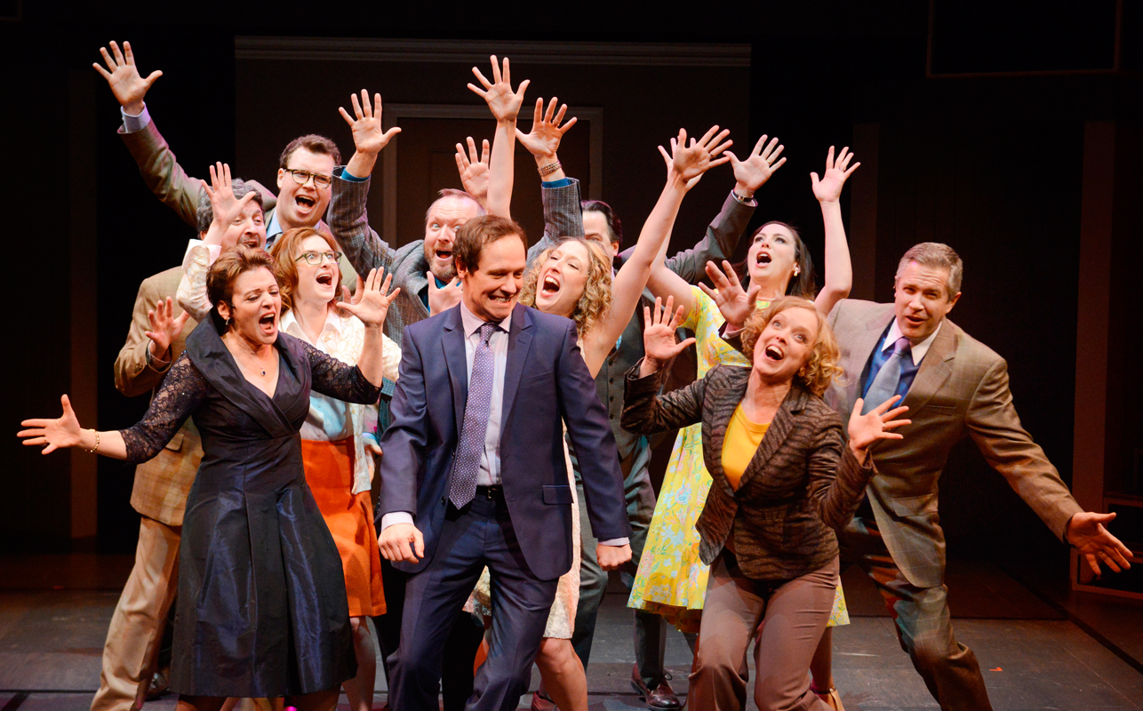 The cast of _Company_ sings around Robert, a single man who is taught by his friends to forgo his inhibitions and embrace married life. Robert is played by Carnegie Mellon alumnus Jim Stanek (CFA '94). (credit: Courtesy of Pittsburgh Public Theater)
