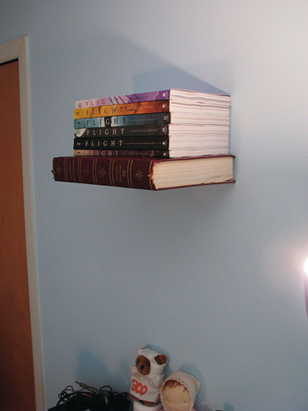 Simply attach bookends to your wall to create a bookshelf that appears to be floating. (credit: Courtesy of P5ycho P3nguin via Flickr)