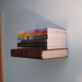 Simply attach bookends to your wall to create a bookshelf that appears to be floating.