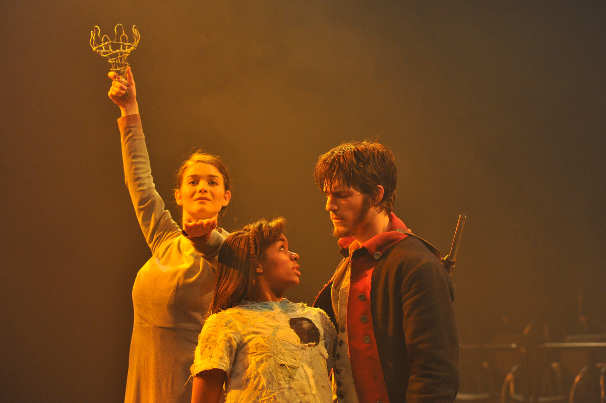 In _The Last Page: A Nuclear Folktale_, Soldier (David Patterson) befriends Little Girl (Alexis Floyd) and the pair go searching for the crown of Statue (Olivia Brown). (credit: Courtesy of Louis Stein)