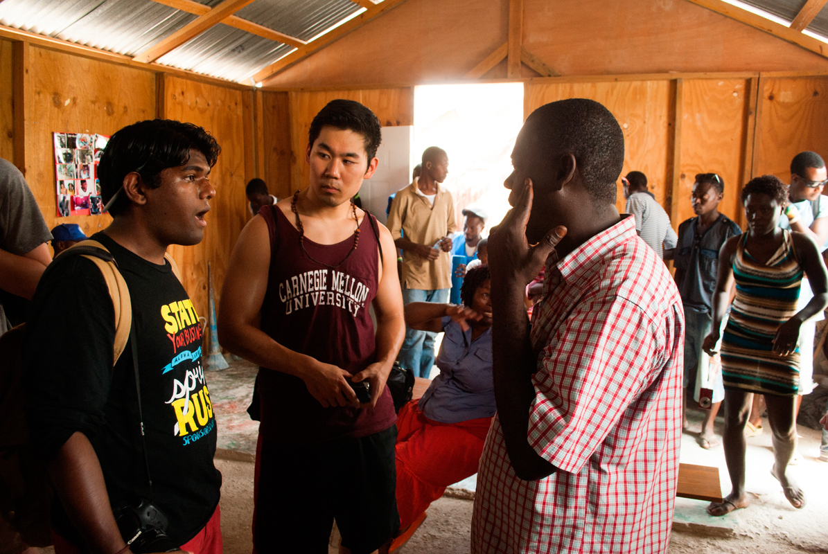 Members of CMU in Haiti discuss the condition of a refugee camp in Delmas, Port-au-Prince, Haiti with its directors.  (credit: Courtesy of Holly Dennis)
