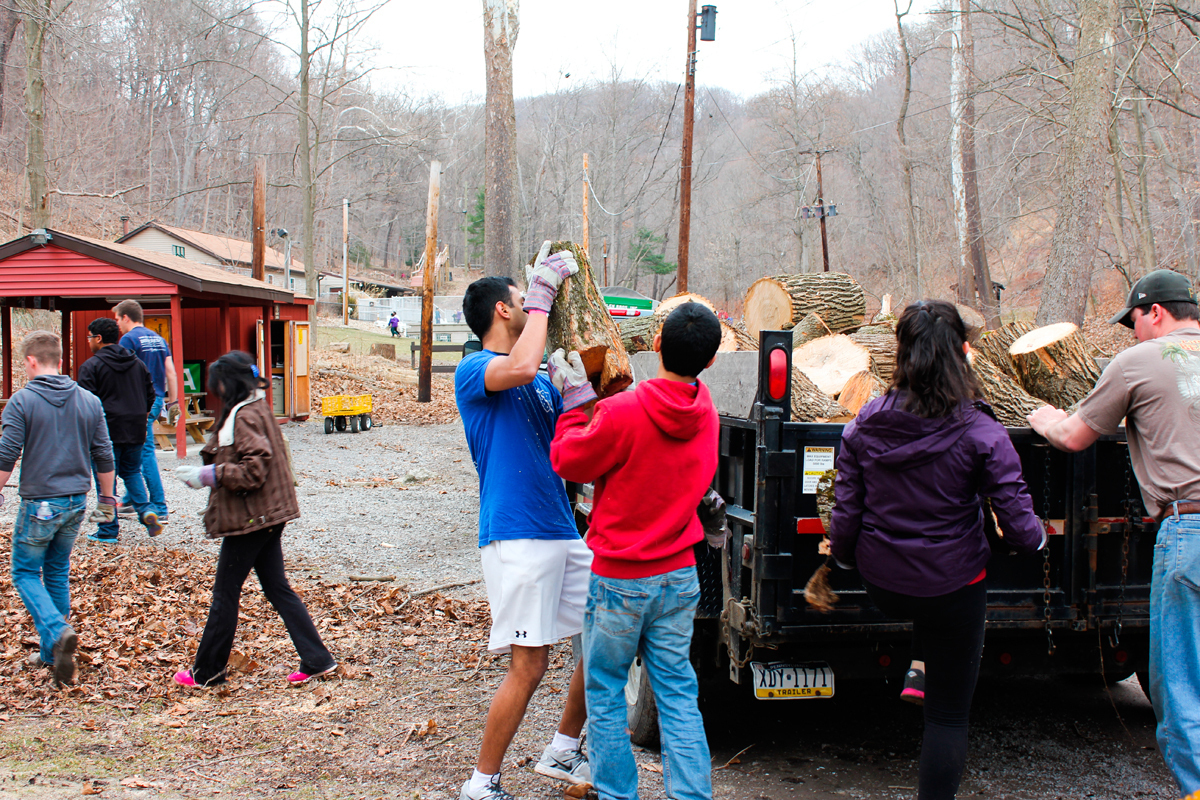 Students representing several student organizations loaded up lumber at Camp Guyasuta, a nearby Boy Scouts camp, as part of 1000plus.  (credit: Courtesy of Kristen Chon)
