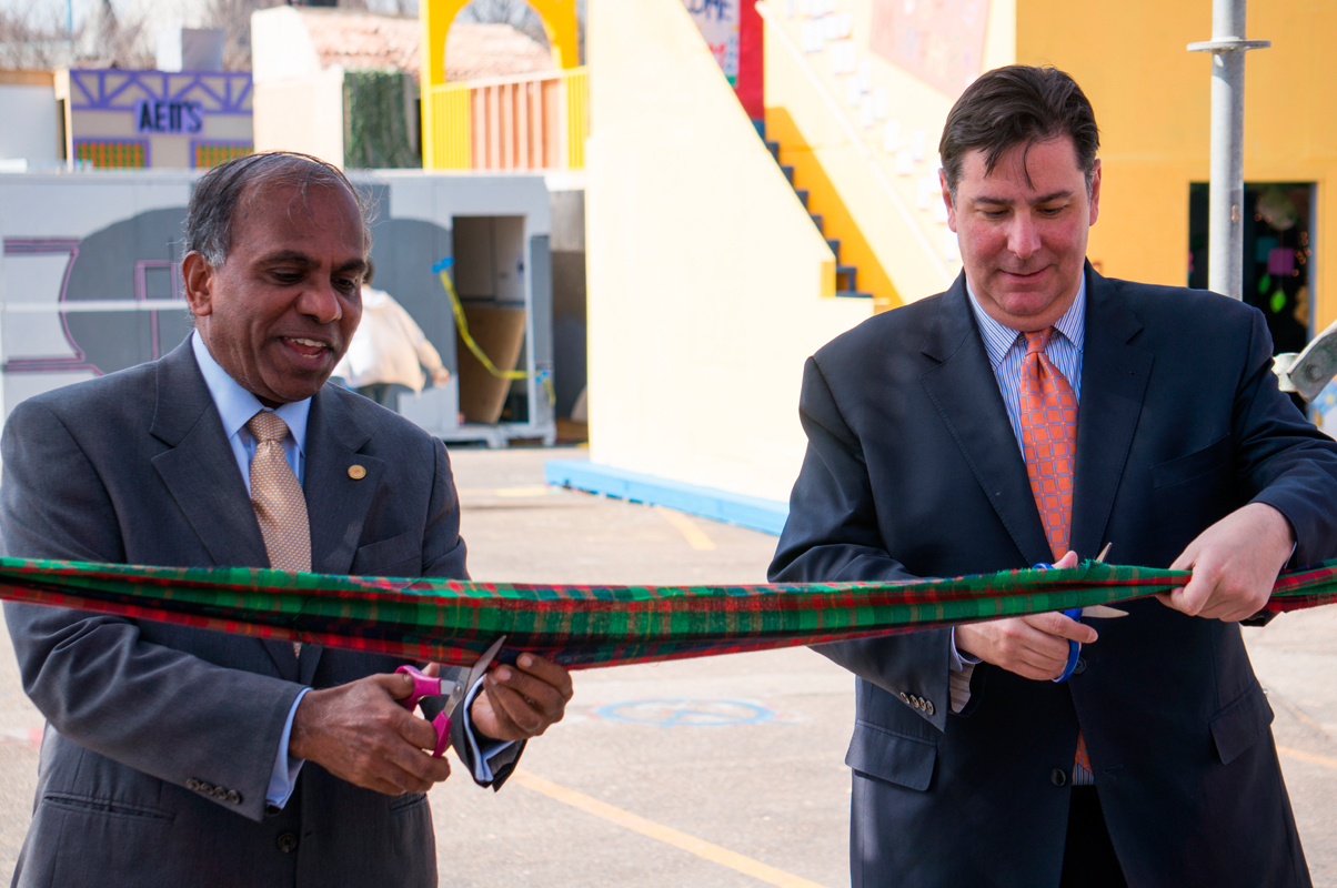 University President Subra Suresh (left) and Pittsburgh Mayor Bill Peduto (right) cut the plaid ribbon to officially open Midway and begin Carnegie Mellon's 100th Spring Carnival.  (credit: Abhinav Gautam/)