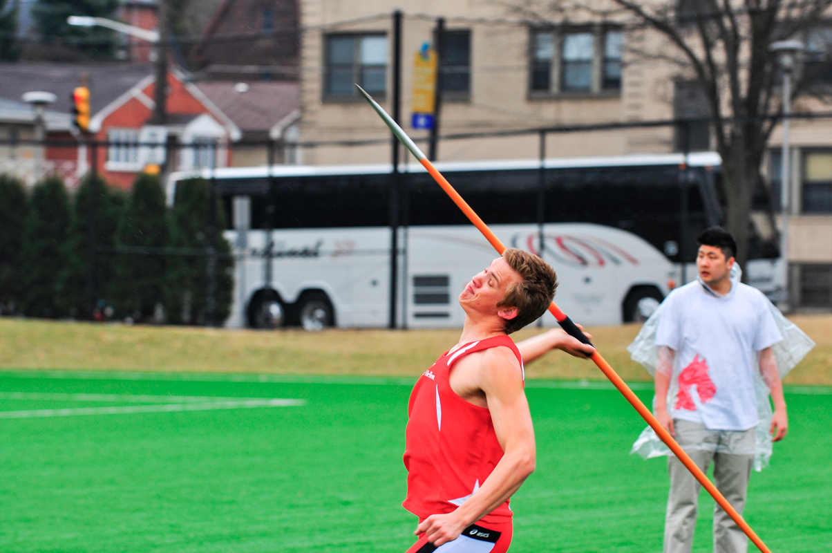 First-year Jacob Brooks readies to launch his javelin for the javelin throw event. (credit: Jason  Chen/)