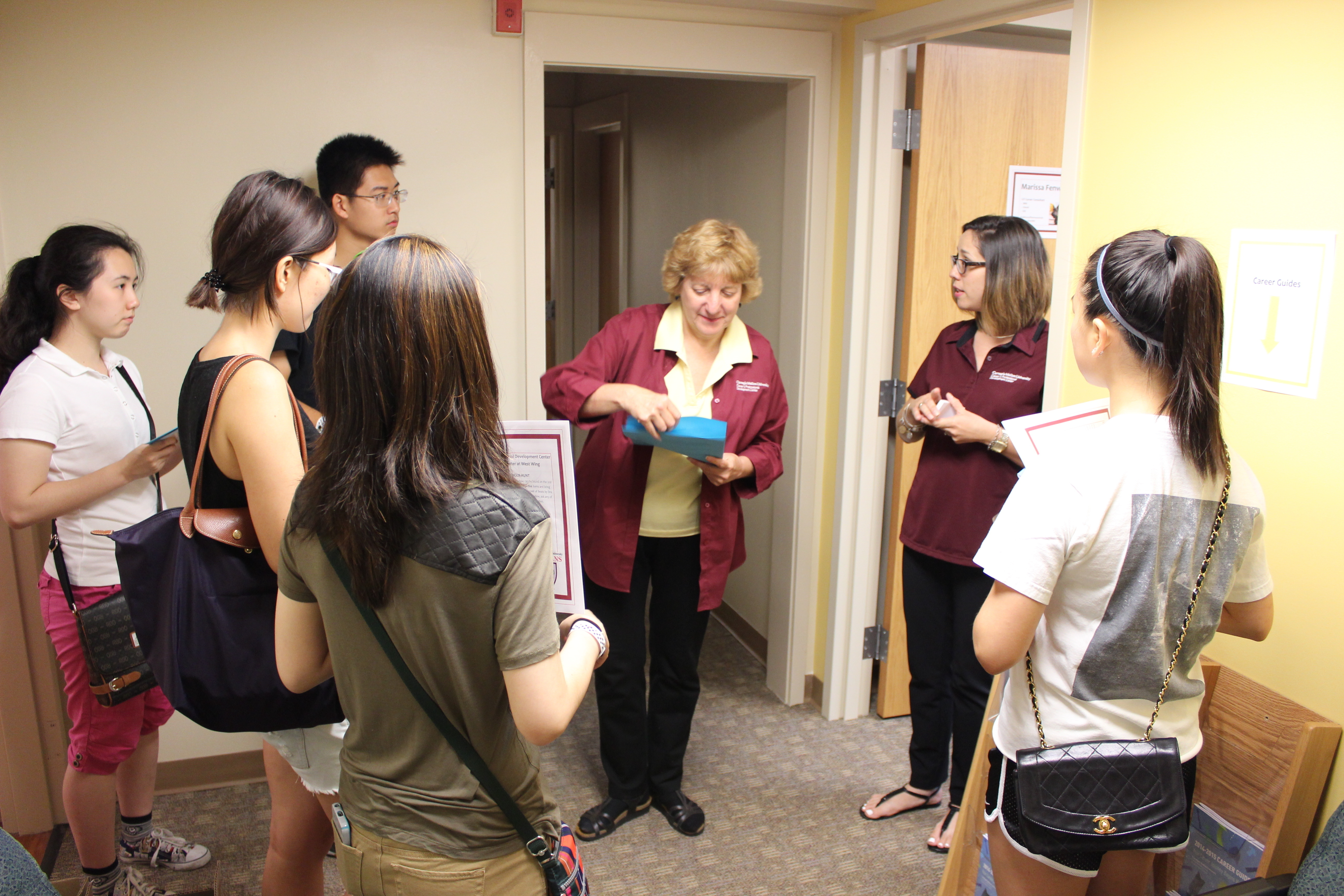 Elaine Stolick, a Career and Professional Development Center assistant director and career consultant for the College of Fine Arts and industry specialist in arts and entertainment, shows students around the CPDC's new West Wing space during a first-year open house on Aug. 22. (credit: Courtesy of Kevin O'Connell of the Career and Professional Development Center)