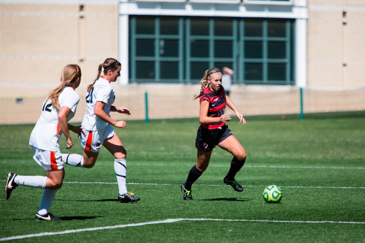 Sophomore forward Megan Bartoshuk avoids defenders as she attempts to score. (credit: Jonathan Leung/Photo Editor)