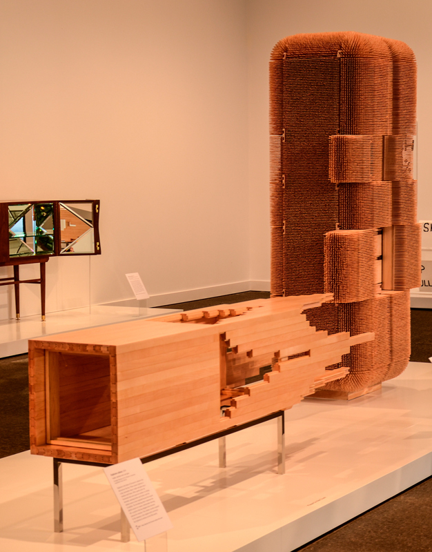 The *Explosion* cabinet (left) and *Magistral* cabinet (right) ask museum visitors to look at ordinary furniture in new ways. (credit: Braden Kelner/Editor-in-Chief)