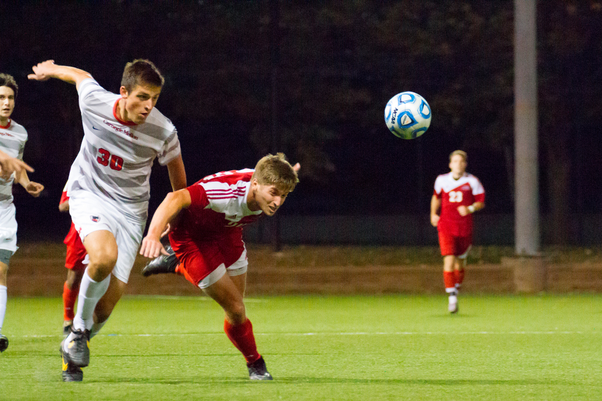 Sophomore defender and midfielder Andreas Fatschel drives the ball down the field. (credit: Kevin Zheng/)