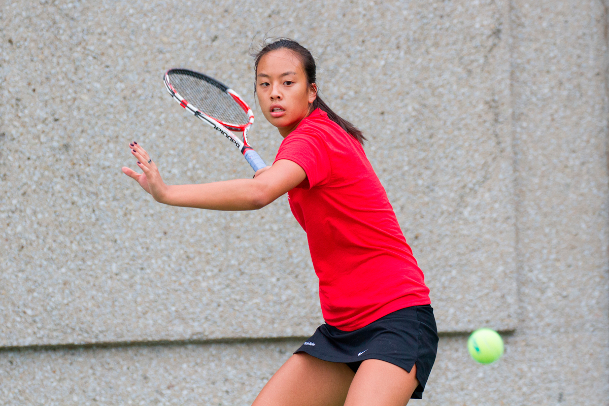 First-year Stacy Chang prepares to return a shot from an opponent. (credit: Kevin Zheng/)