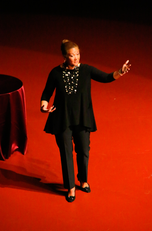 "Michele Norris, host of NPR's All Things Considered, spoke on Wednesday about ""Eavesdropping on America's Conversation on Race."" Norris dances across the stage to express how different races of people can have unique characteristics to their step. (credit: Steven Sun/)"