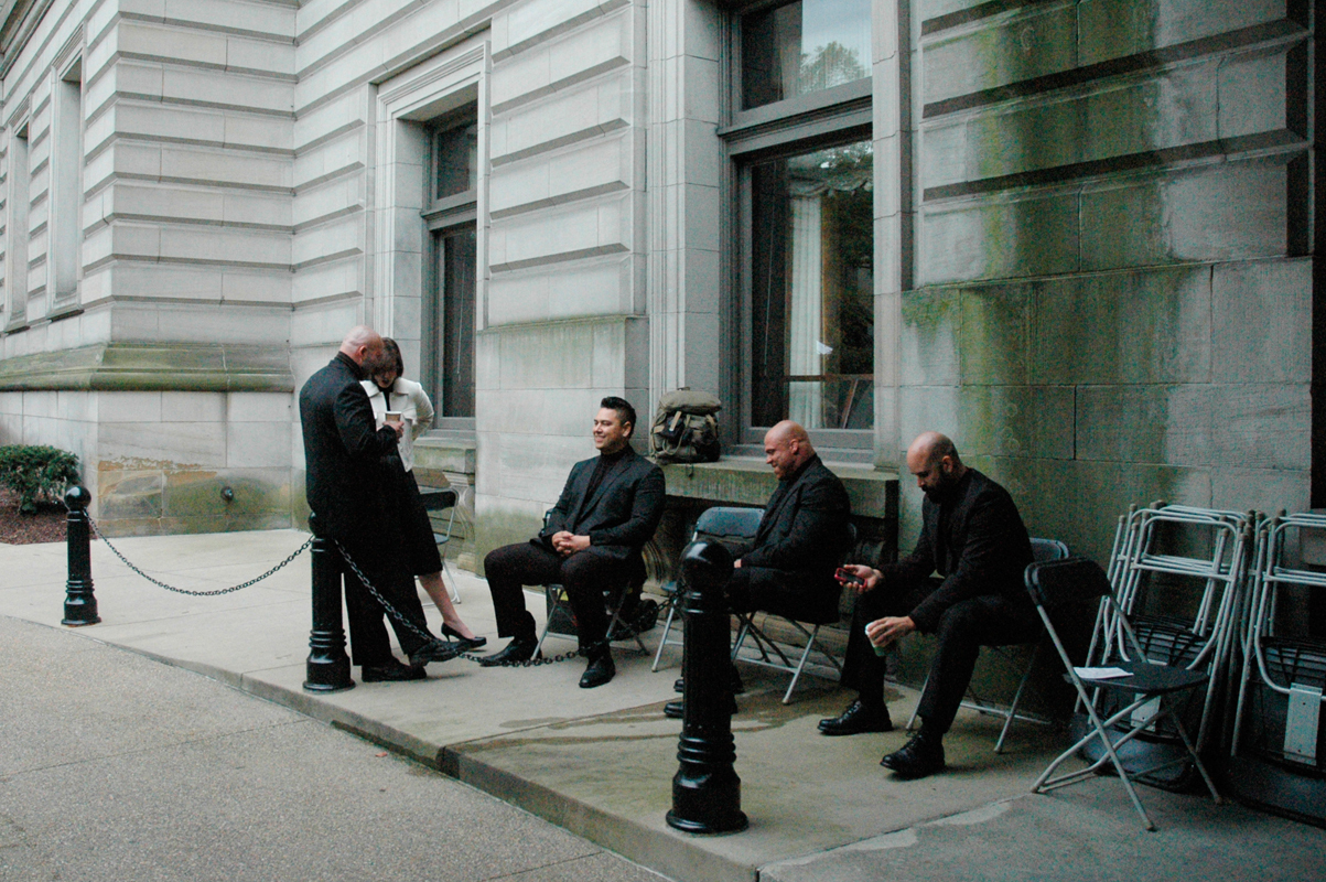 Extras for the film, which stars Vin Diesel, Elijah Wood, and Rose Leslie, sit on set. (credit: Justin McGown/)