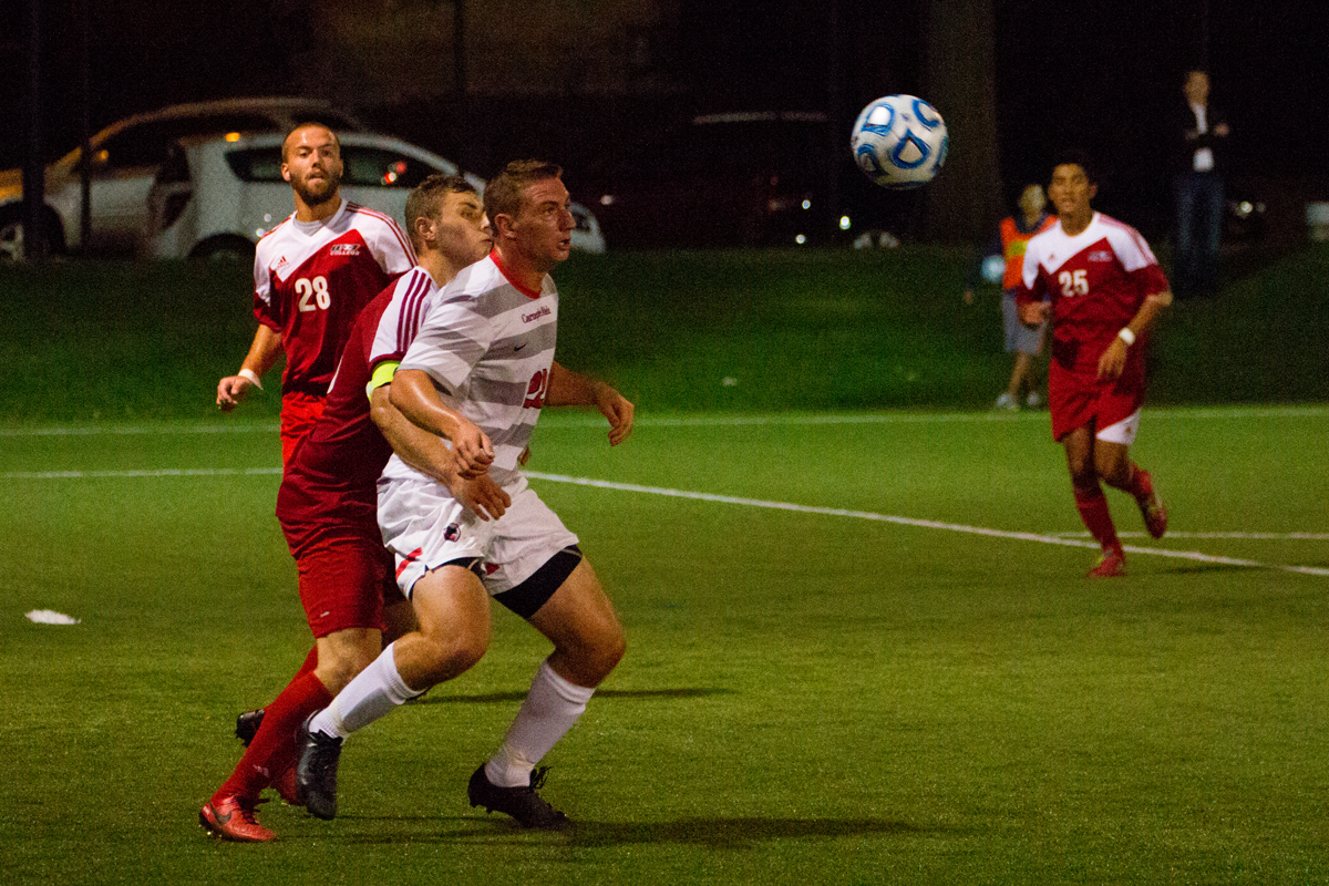 Junior Forward Ben Alderoty positions himself to gain possession of the ball. (credit: Staff Photographer)