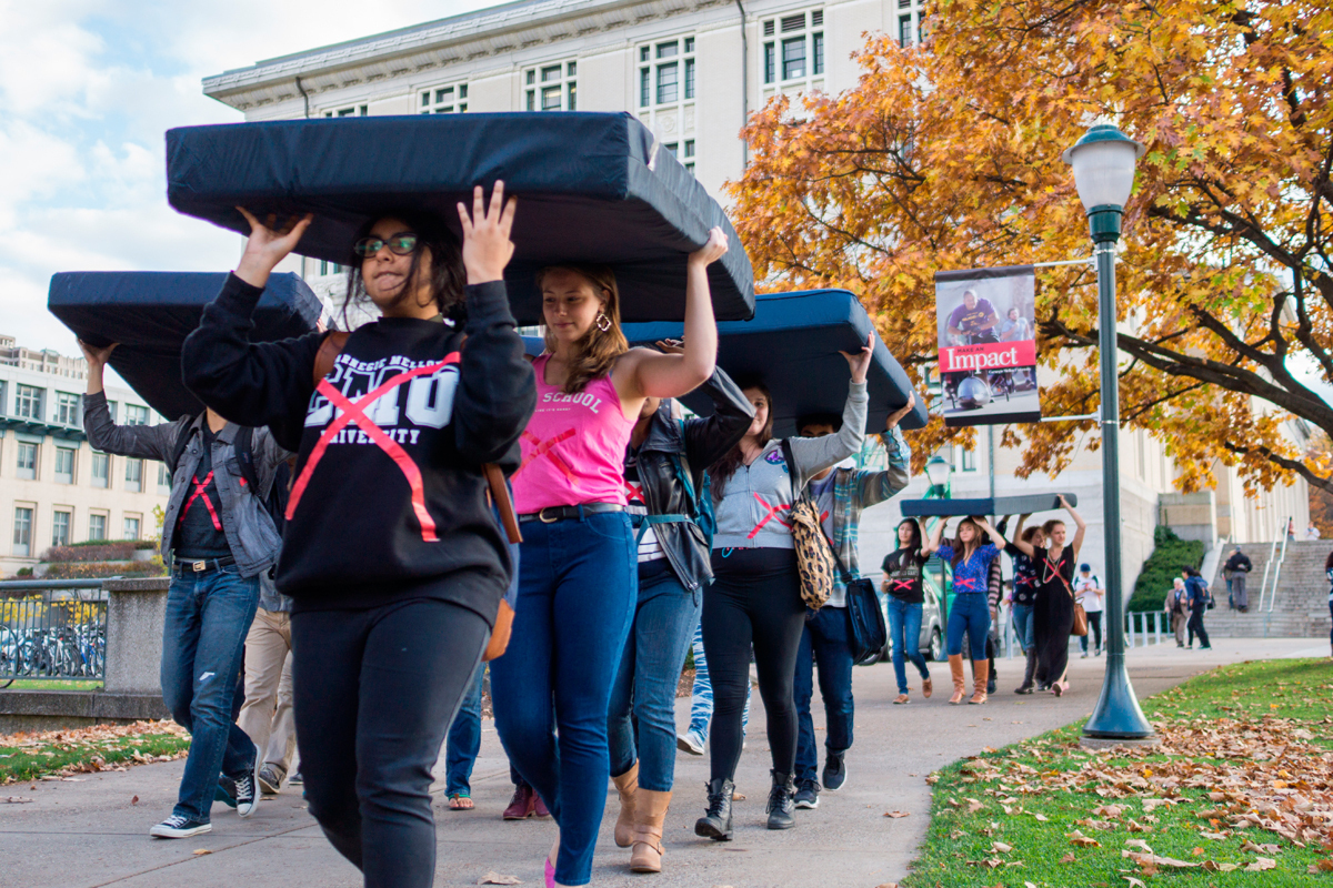 As part of a national day of awareness and activism, students carried their mattresses around campus on Wednesday and wore X's on their clothing in support of sexual assault survivors.  (credit: Yeongwoo Hwang/)