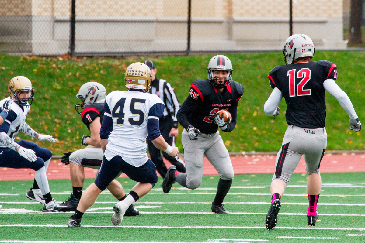 Sophomore safety Samer Abdelmoty carries the ball on a kick return. (credit: Staff Photographer)