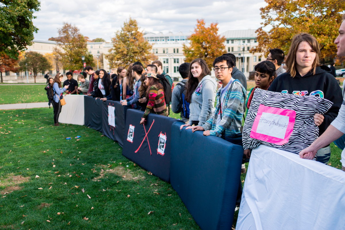 Participating students lined up in front of the Fence Wednesday afternoon after carrying their mattresses. (credit: Yeongwoo Hwang/)