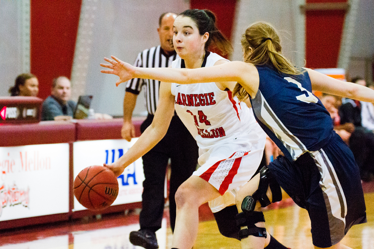 Sophomore guard Jackie Hudepohl drives to her right. (credit: Staff Photographer)