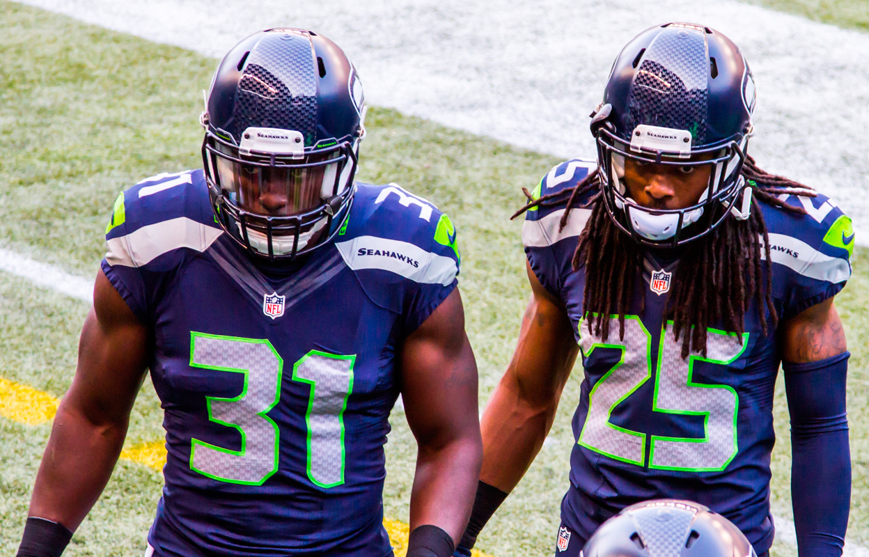 Richard Sherman and Kam Chancellor, one half of the 'Legion of Boom,' enter the huddle (credit: Courtesy of Mike Morris via Wikimedia Commons)