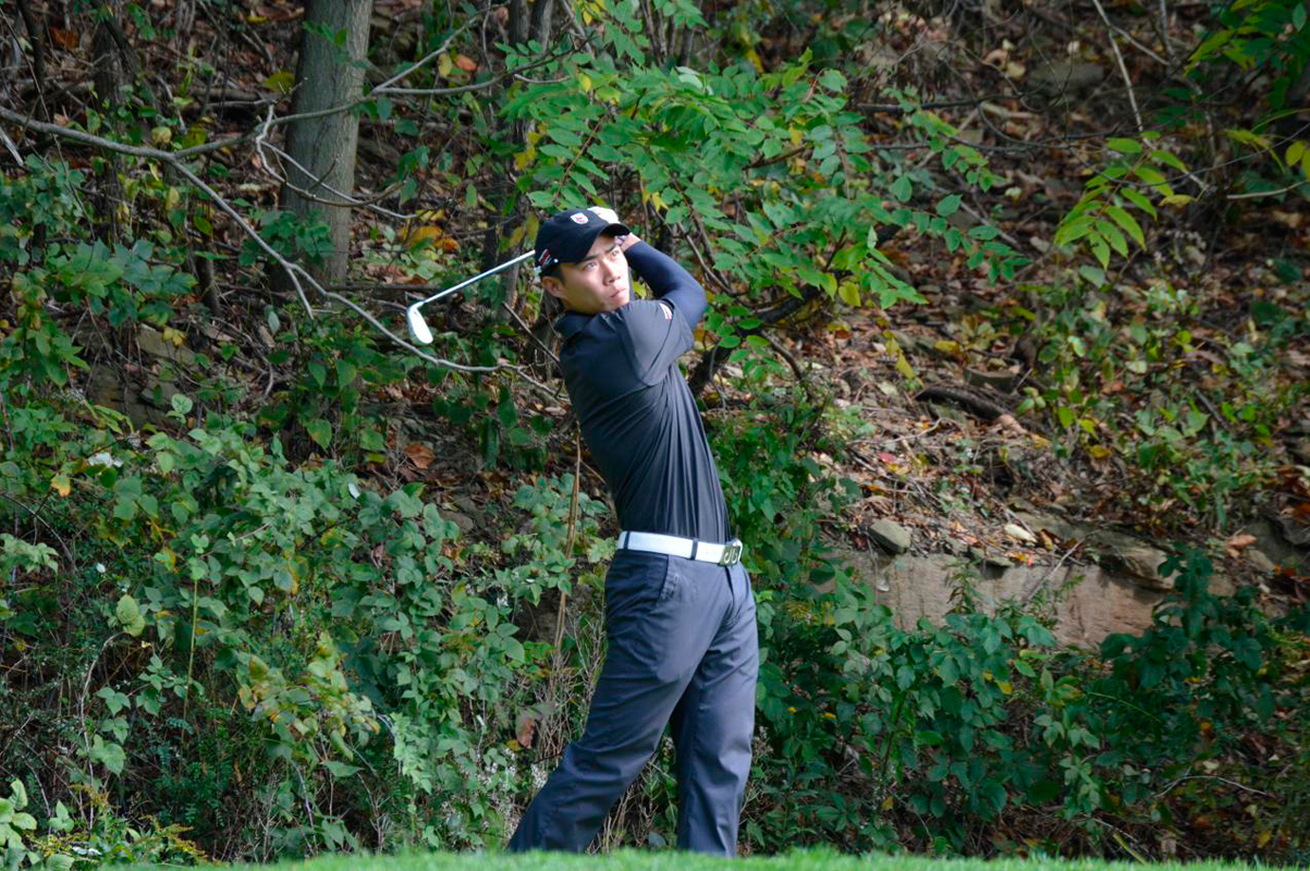 Qian holds his follow through as he watches a shot. (credit: Courtesy of CMU Athletics)