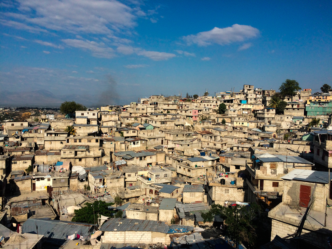 These Haitian homes are overcrowded and tightly packed, creating a moving and beautiful horizon.
