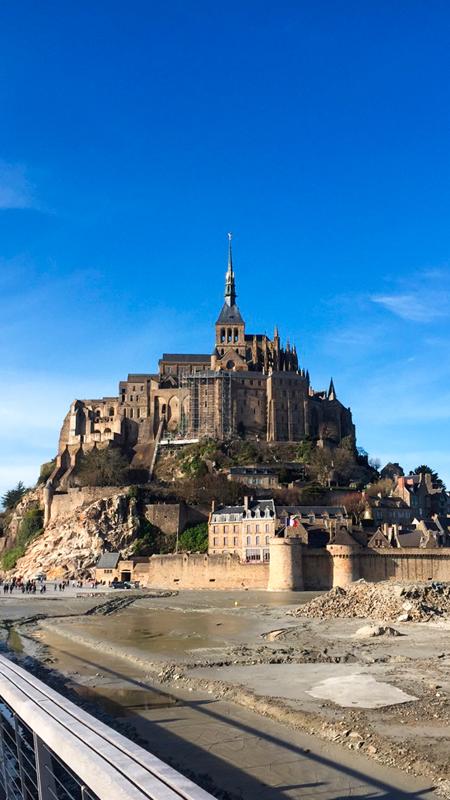 The beautiful Mont Saint-Michel castle is an ancient monastery  on an island in Normandy and offers tourists unparalleled traveling experience.
