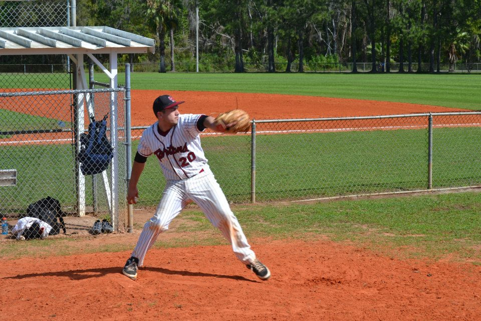 Darren Kerfoot throws a pitch during warmups. (credit: Courtesy of CMU Baseball)
