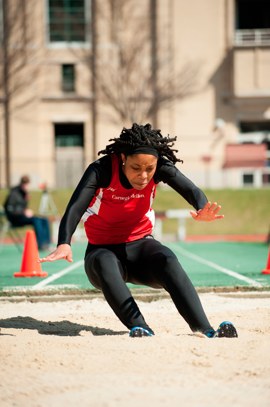 Sasha Spalding braces herself as she lands in the long jump.