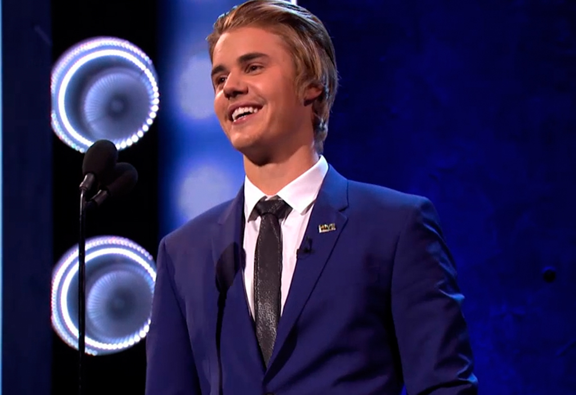 Roast muse Justin Bieber keeps a composed smile amid the ruthless banter of Comedy Central stars. (credit: Courtesy of Comedy Central)