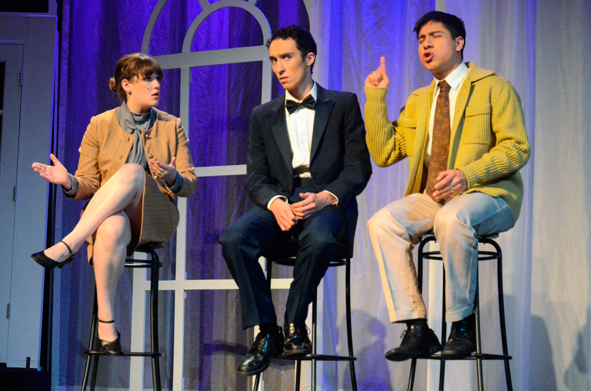 First-year art major Melanie Anderson plays a television host in the scene where junior vocal performance major Camilo Estrada's Charley (right) embarrasses his friend Frank (center), played by sophomore vocal performance  major Angelo Ragghianti, on live television.  (credit: Danielle Hu/)