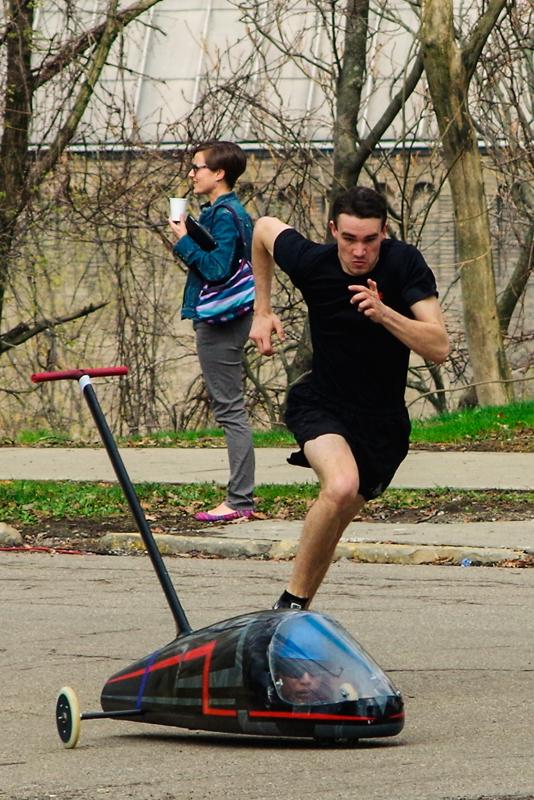 Senior mechanical engineering student Glenn Philen chases the buggy. (credit: Greg Hanneman/Senior Staffwriter)