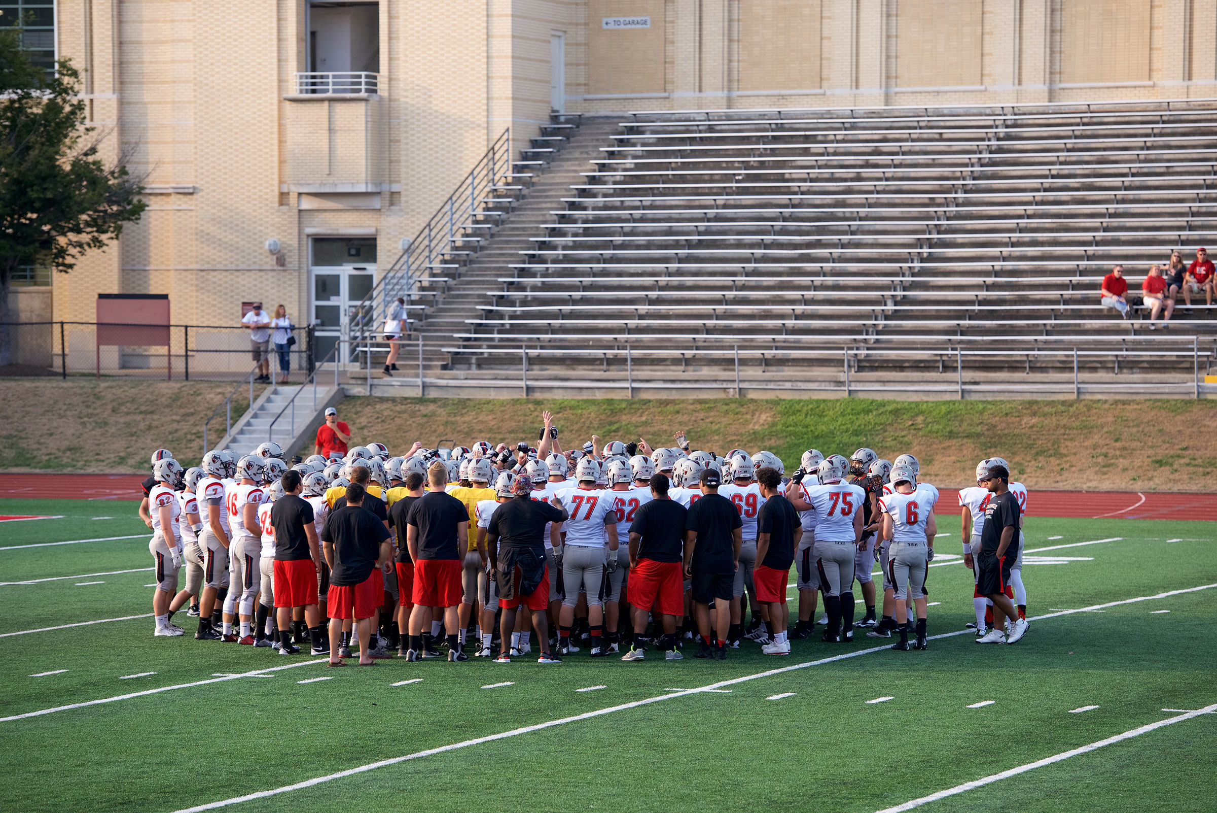 The Tartans huddle on the field at the scrimmage. (credit: Staff Photographer)