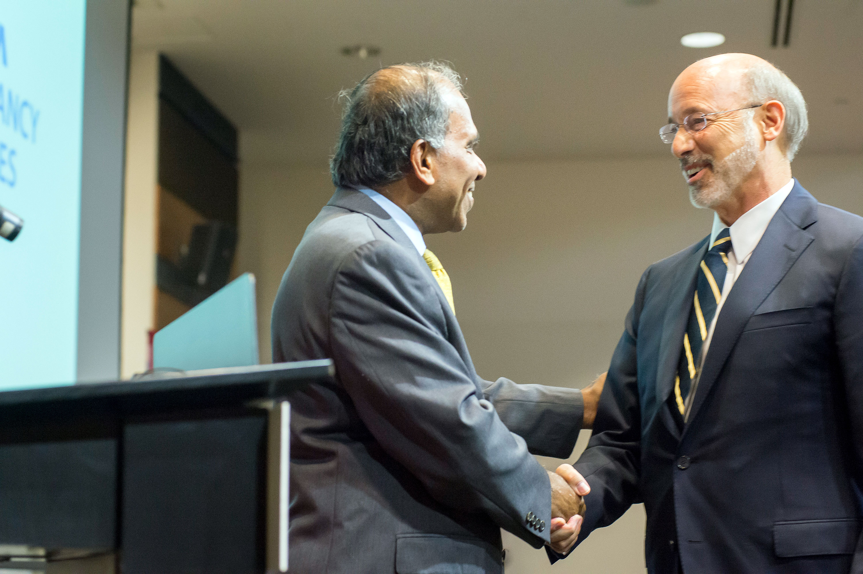 Governor Tom Wolf and Subra Suresh shake hands.