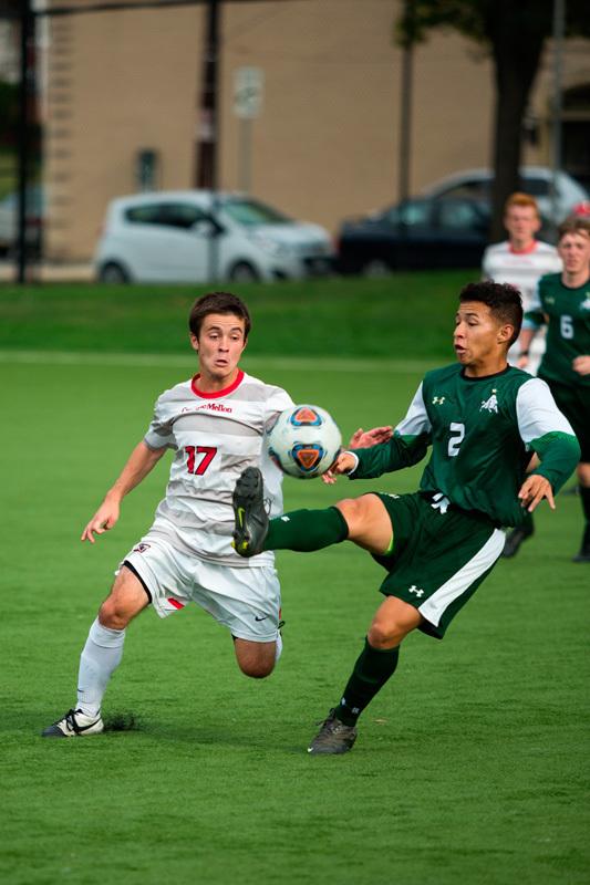 Junior midfielder Tristan Lockwood attempts to regain possession. (credit: Staff Photographer)