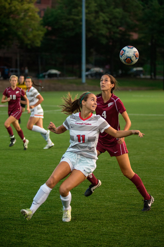 Senior Forward Ali McGuigan positions herself for a header. (credit: Staff Photographer)