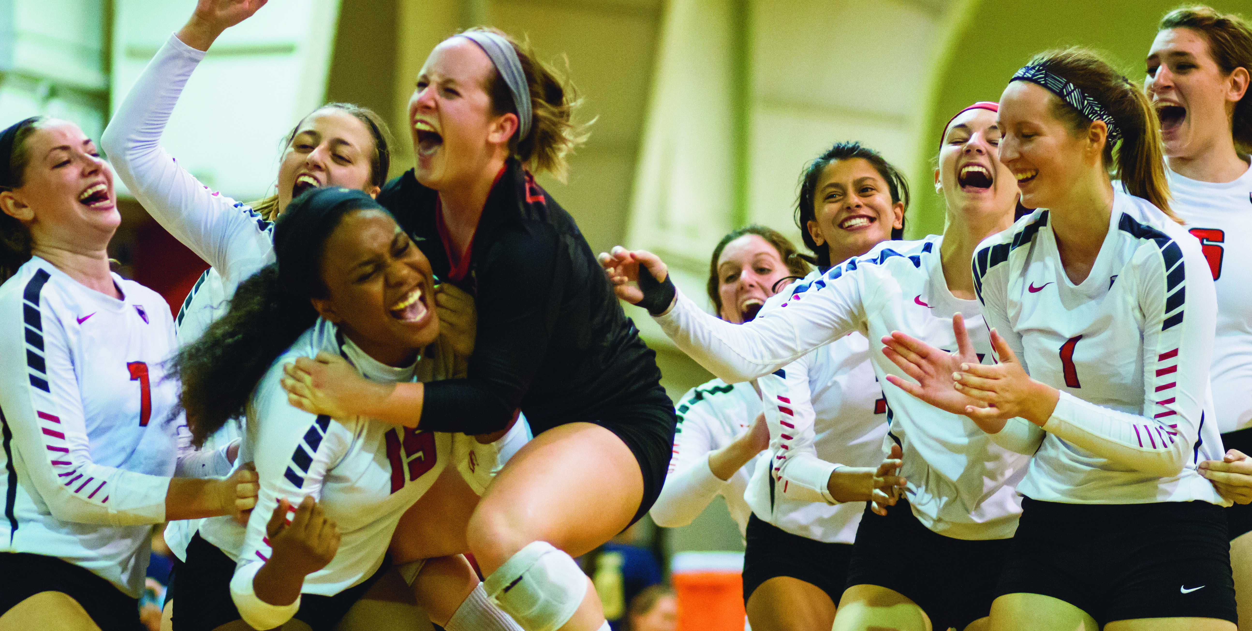 The volleyball team celebrates after coming back from a deficit. (credit: Staff Photographer)