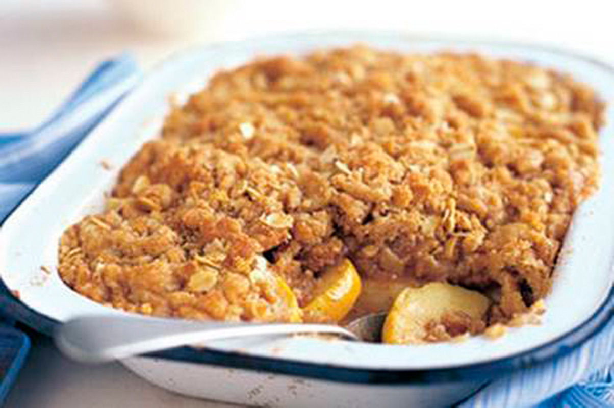 Warm apple crumble is an easy and delicious way to get your fruit serving for the day, albeit with a side of butter. (credit: Courtesy of Flickr Creative Commons)