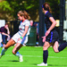 Senior forward Alli McGugan crosses the ball to set up an opportunity for the Tartans.