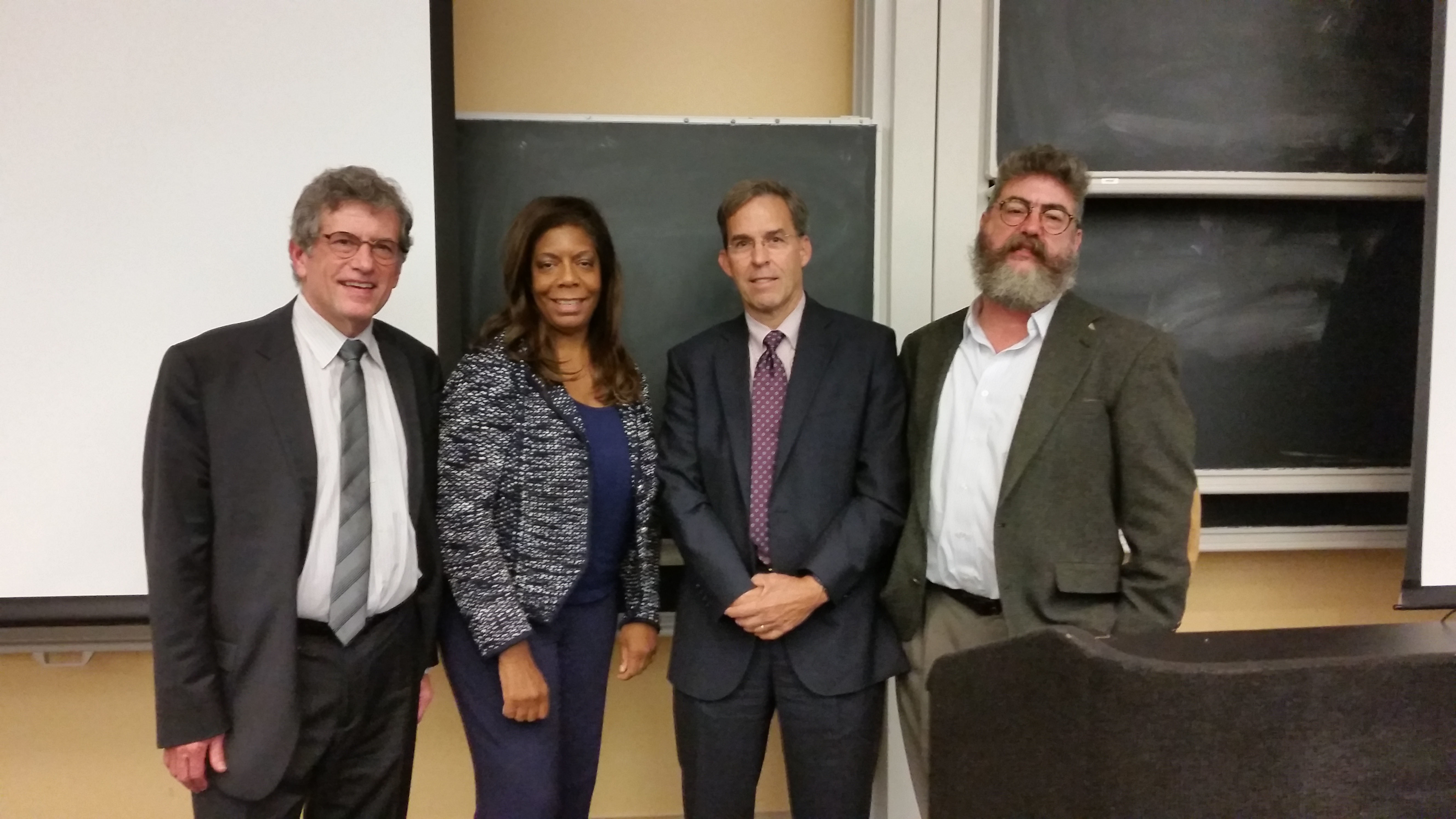 """Organizers of the event """"War and the Humanities"""" stand for a picture: David Shumway, Kiron Skinner, author Rick Atkinson, and Timothy Haggerty. (credit: Valene Mezmin/)"""