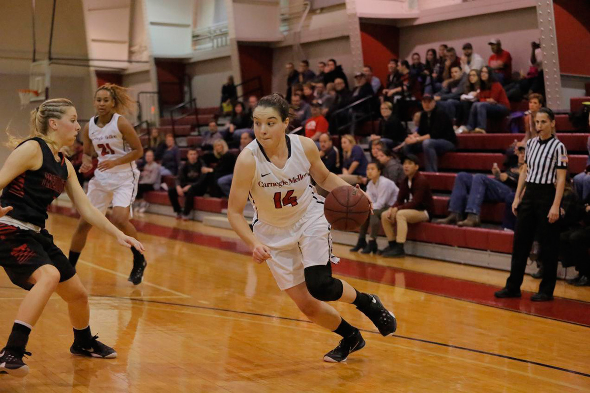 Junior guard Jackie Hudepohl drives to the basket from the perimeter. Hudepohl scored 14 points. (credit: Courtesy of CMU Athletics)