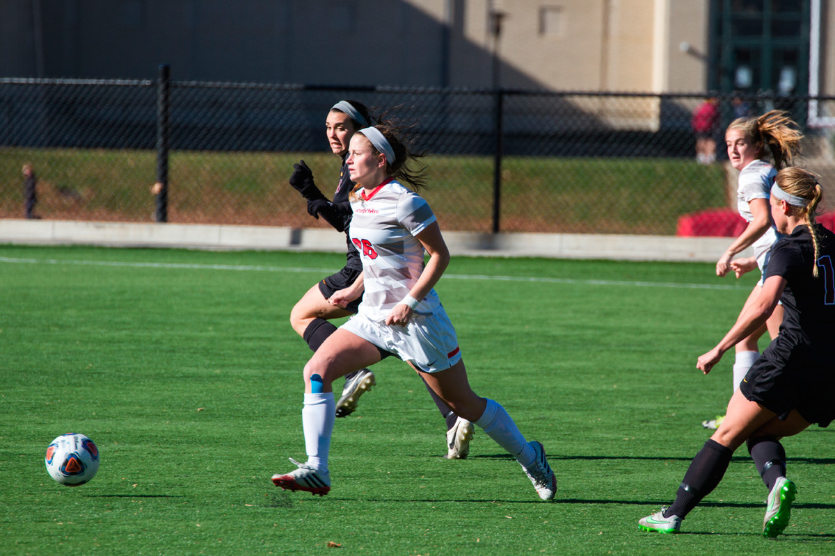 Defender Amelia Clark surveys the field to pick out a spot for a clearance. (credit: Assistant Photo Editor)